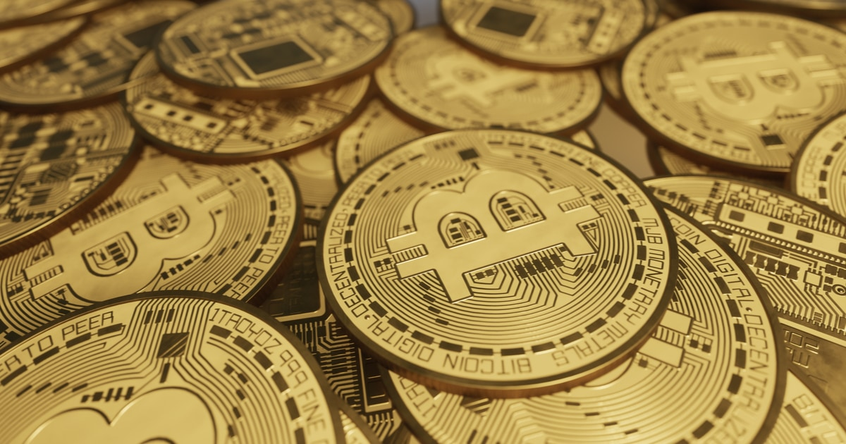 pile of Bitcoins on a table