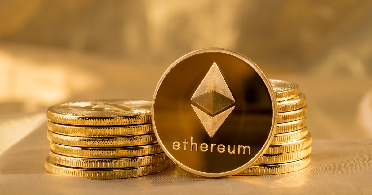 Stack of ether coins or ethereum on gold background to illustrate blockchain